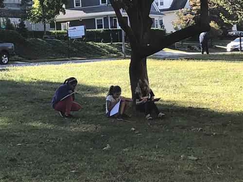 Students writing outside
