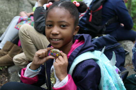 Morse second-graders place kindness rocks on trails at The Peabody Preserve.