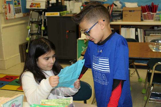 Students share poems as part of Poem In Your Pocket day