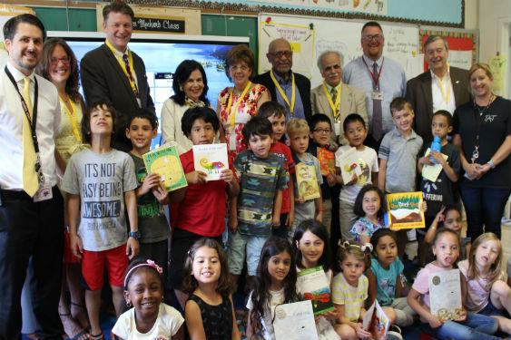 Rotary donates books to elementary students.