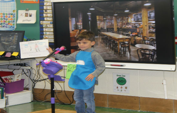 Kindergarten students open up Starbooks at John Paulding