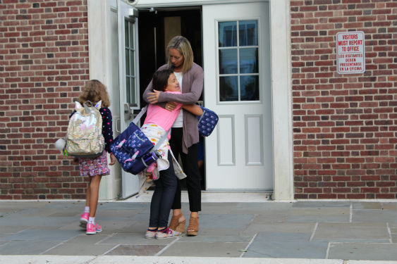 New Assistant Principal at WI greets students.