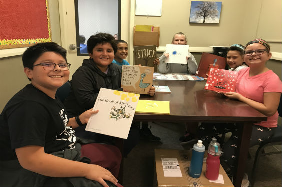 Fifth-grade students read to younger students at Washington Irving.